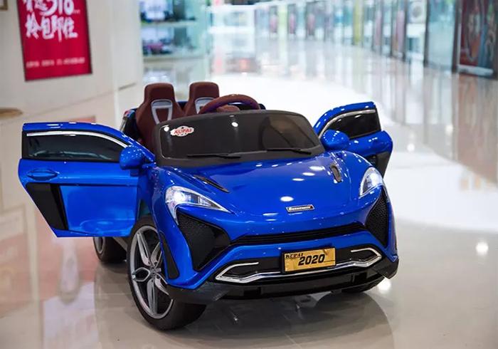 Ô tô điện trẻ em tự lái Mclaren 2020 màu Xanh